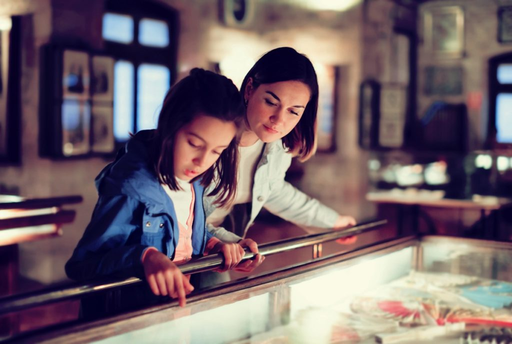Parent and daughter in a museum