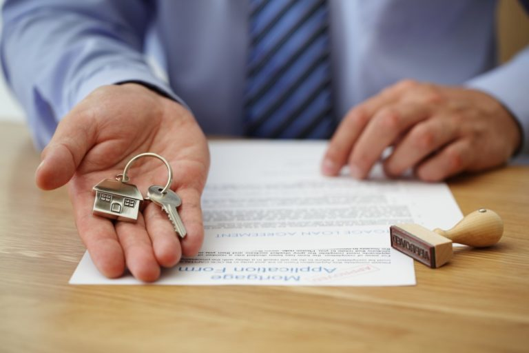 man giving the key to a new home
