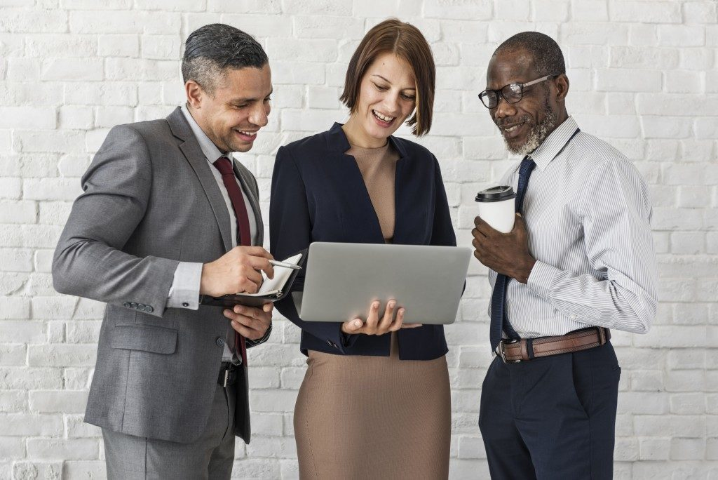 executives looking at a laptop