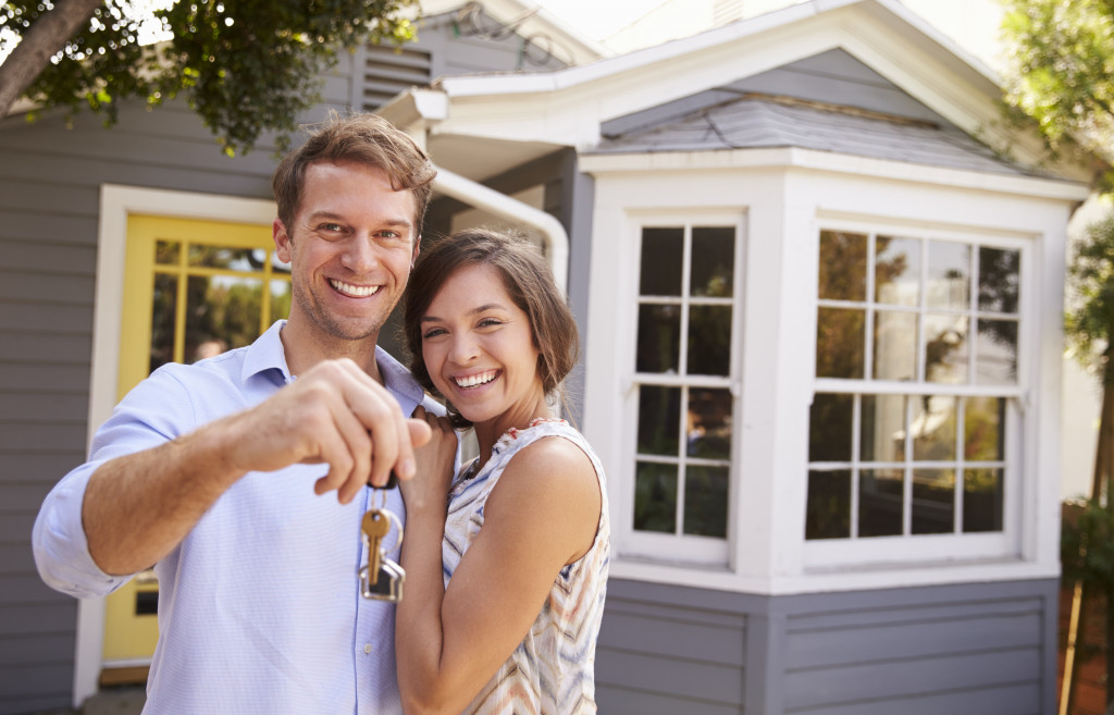 Couple holding keys to new house