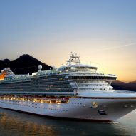 Luxury cruise ship sailing during sunrise